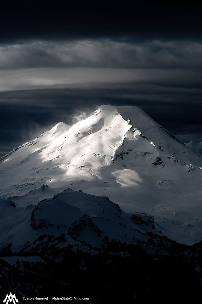 Howling winds swirl snow on stormy Mount Baker.