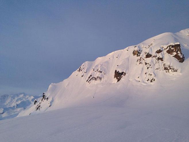 Liz bombing the runout in beautiful Alaskan light.