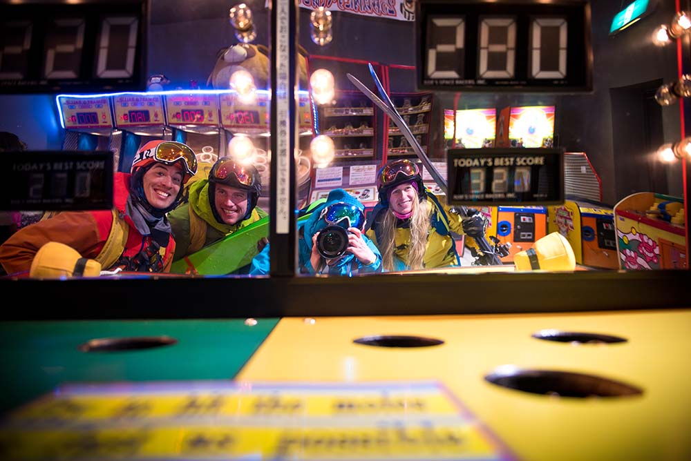 The crew visits a Japanese arcade wearing full ski gear.