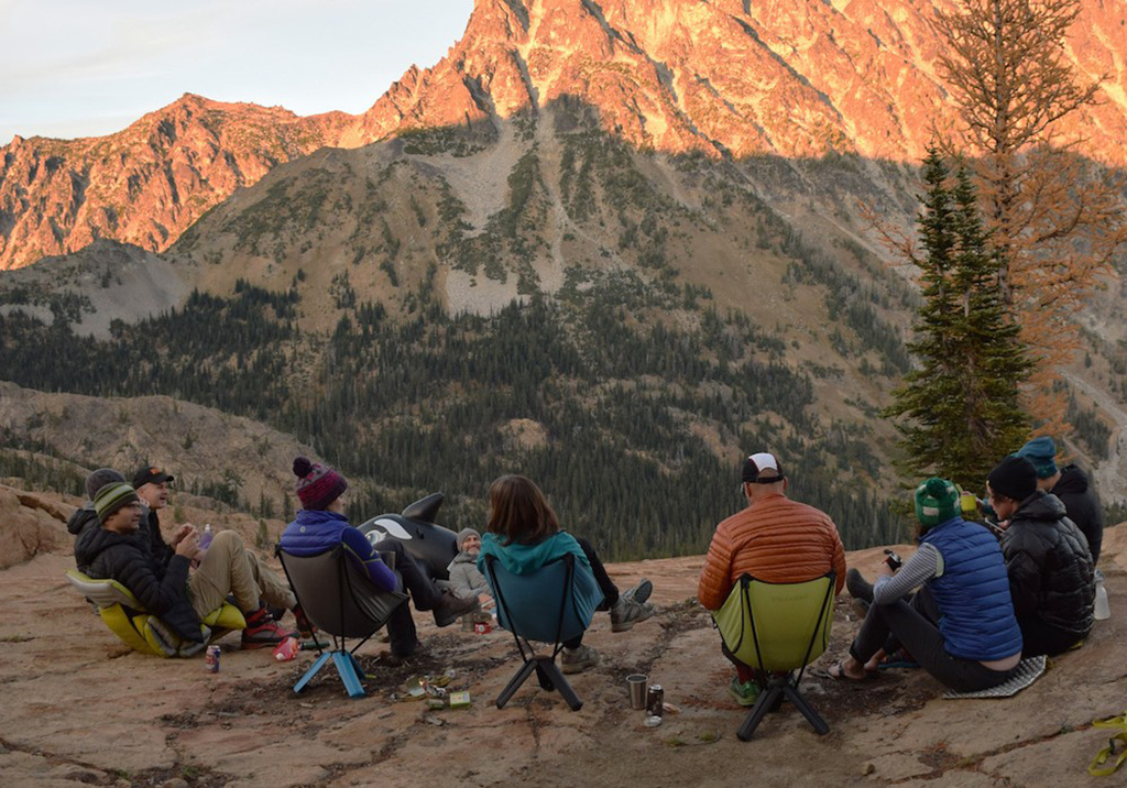 sitting in camp chairs on backpacking trip