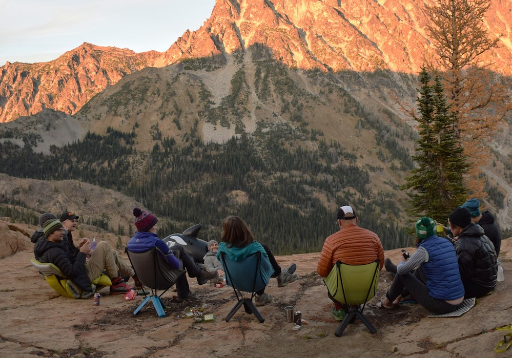 group sitting in camping chairs