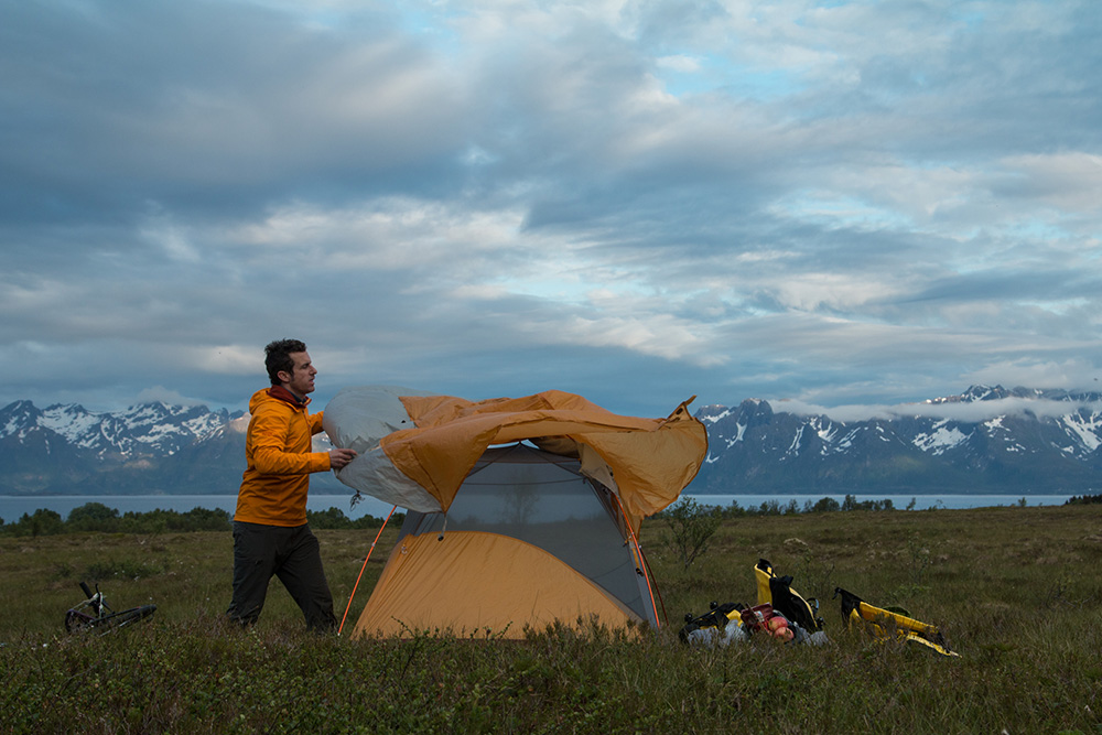 setting up backpacking tent on one-night backpacking trip