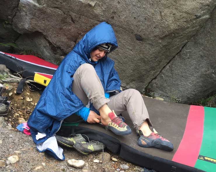 woman wearing a poncho before climbing