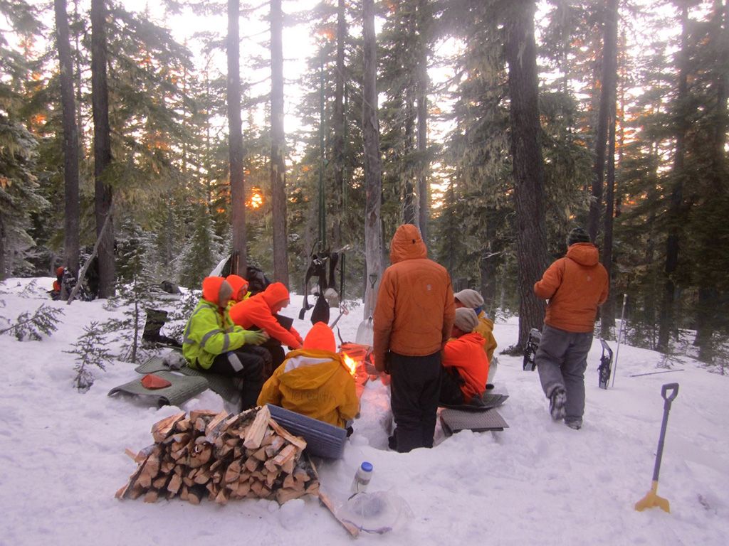 group camping around fire
