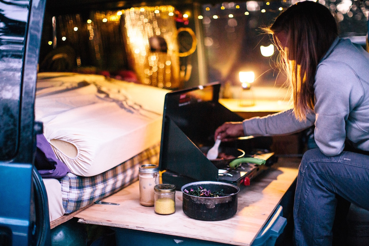 cooking on a stove in a van