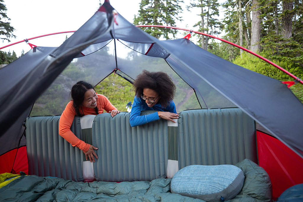 sleeping pads and pillows in tent