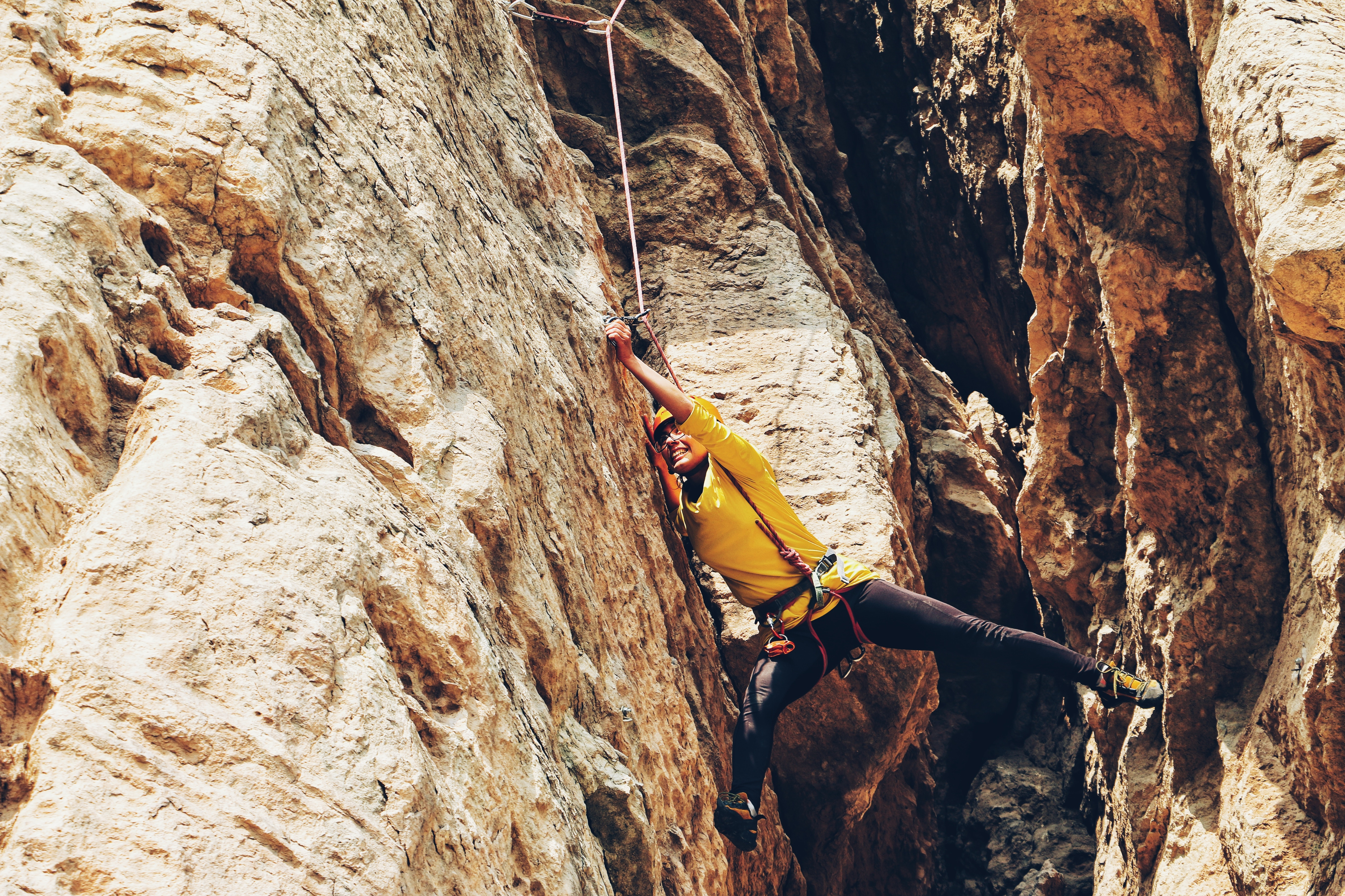 Rock climber problem solving a route outside