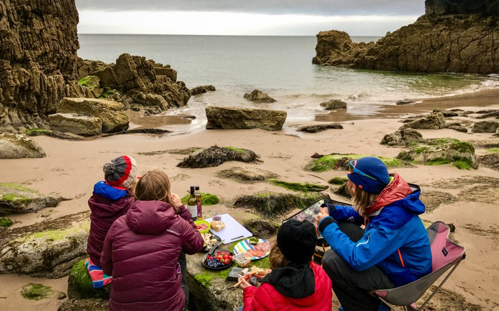 family eating and beach camping