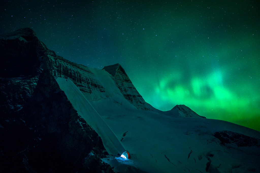 snow camping under the northern lights