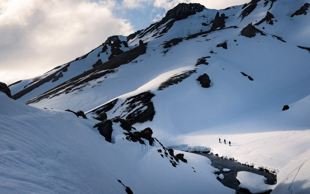 trekking across snowy mountain