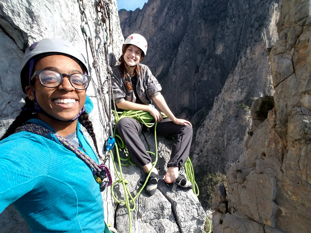 friends rockclimbing together