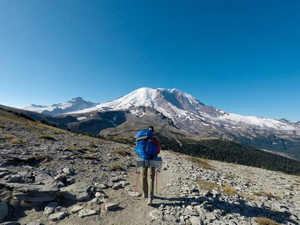 backpacking on mountain with trekking poles