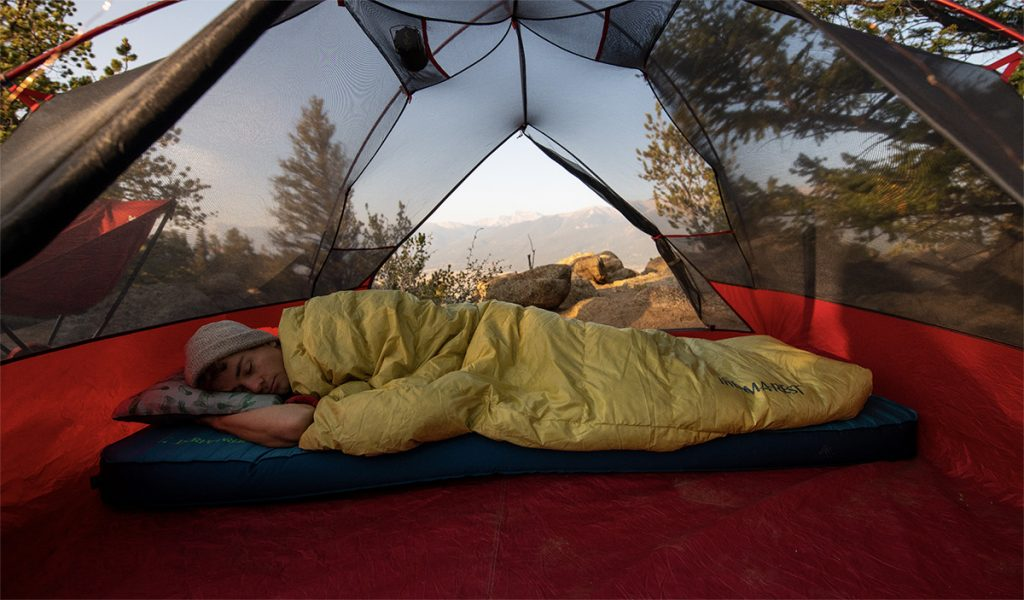 sleeping with camping quilt