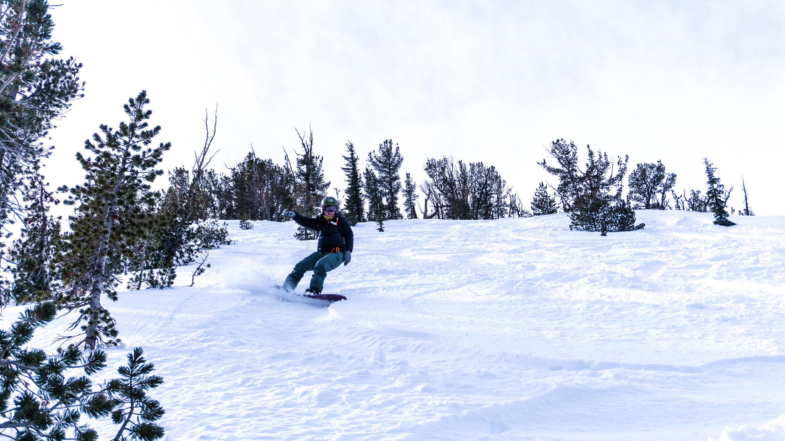 Woman outdoors snowboarding at Tamarack Peak