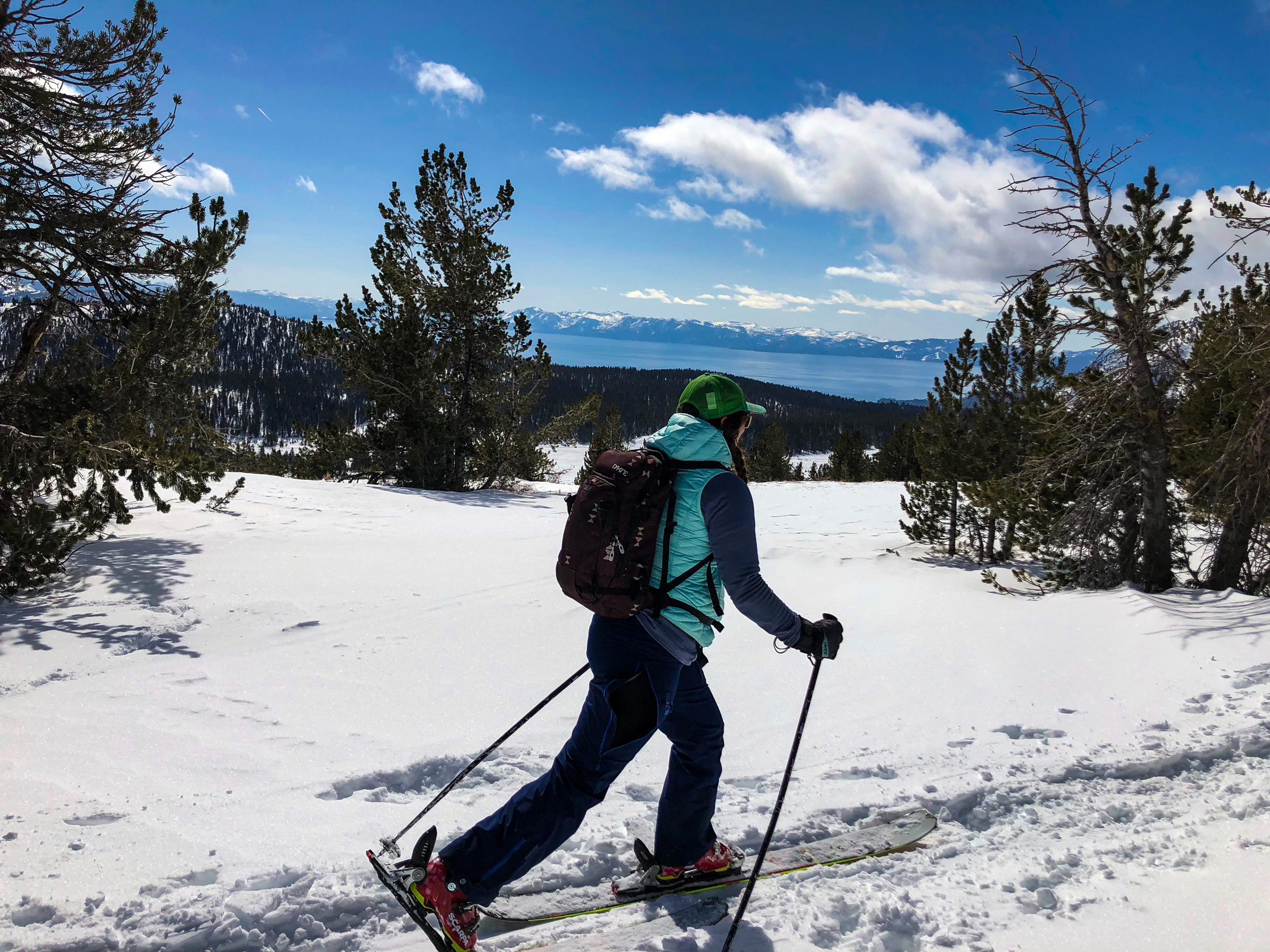 Woman outdoors splitboarding at Tamarack Peak