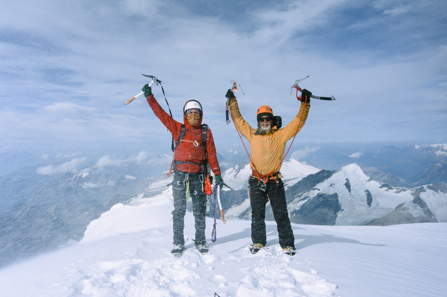 Climbers standing on top of the summit of Mount Robson