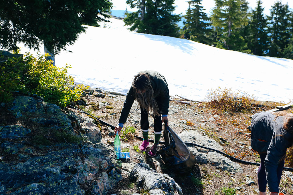 leave it better than you found it - cleaning up trash on trail