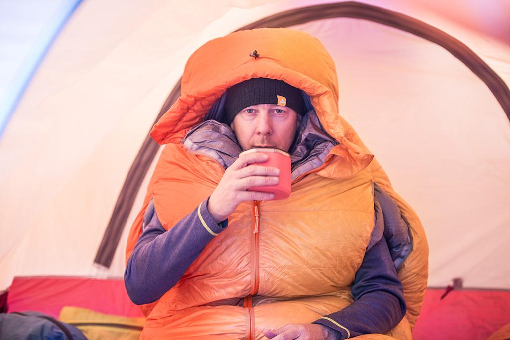 drinking warm drink in polar ranger sleeping bag