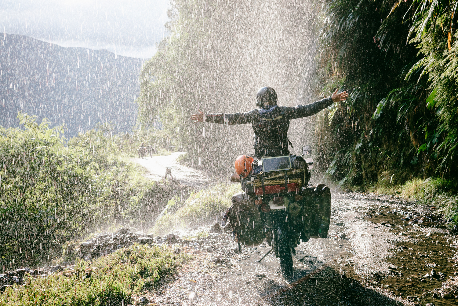 Motorcycle under a waterfall