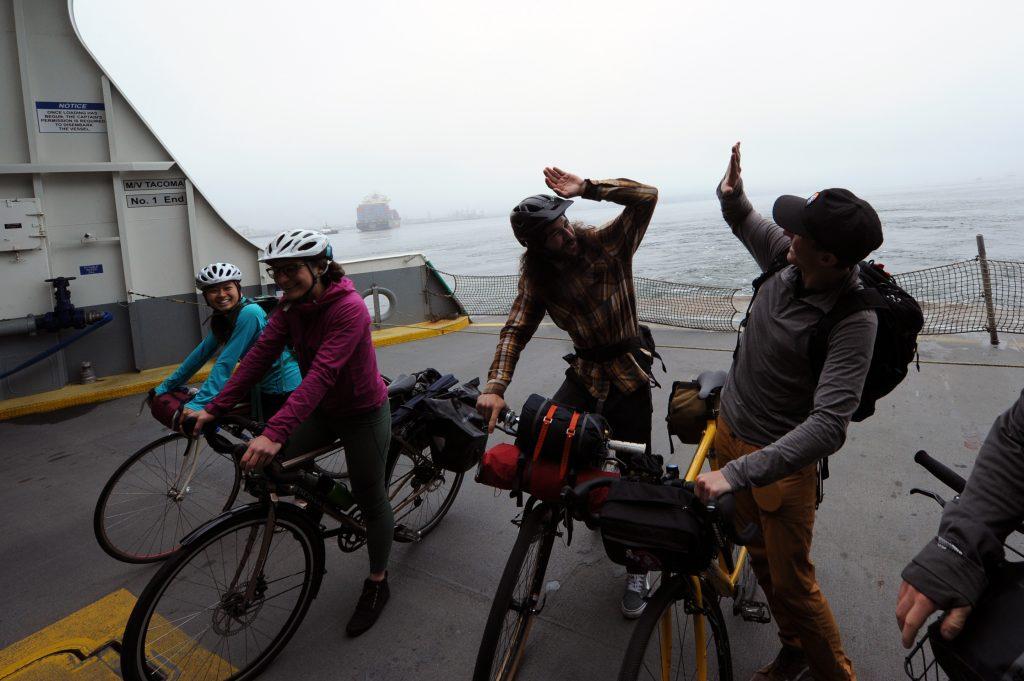 high five on bikepacking trip on ferry