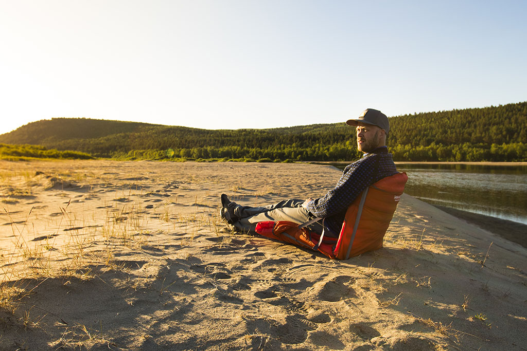 sitting in camping chair
