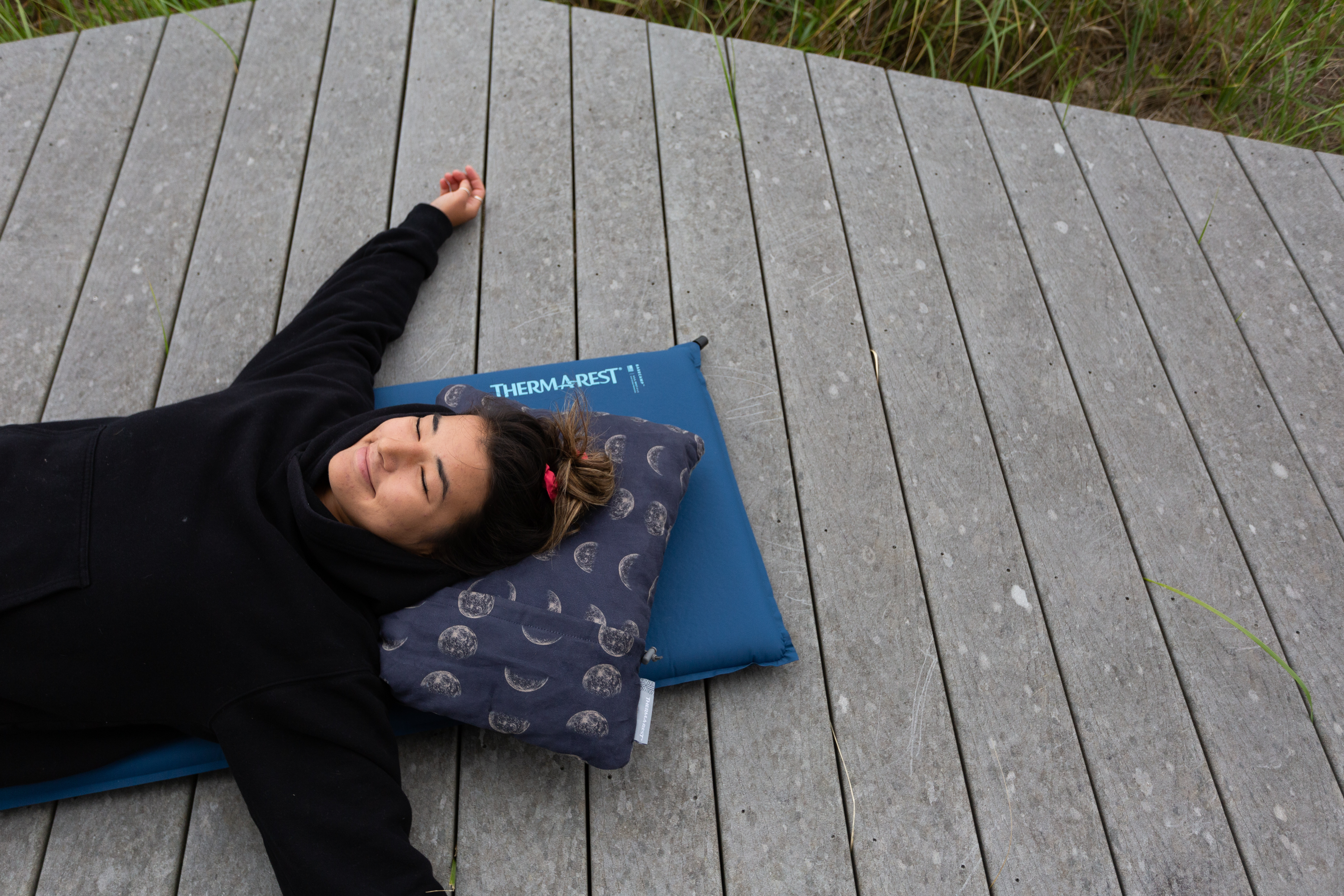 Relaxing on a Therm-a-Rest sleeping pad