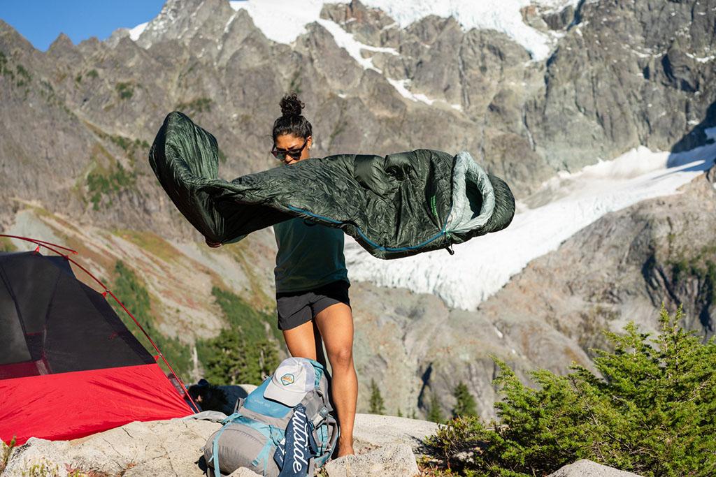 women opening up sleeping bag