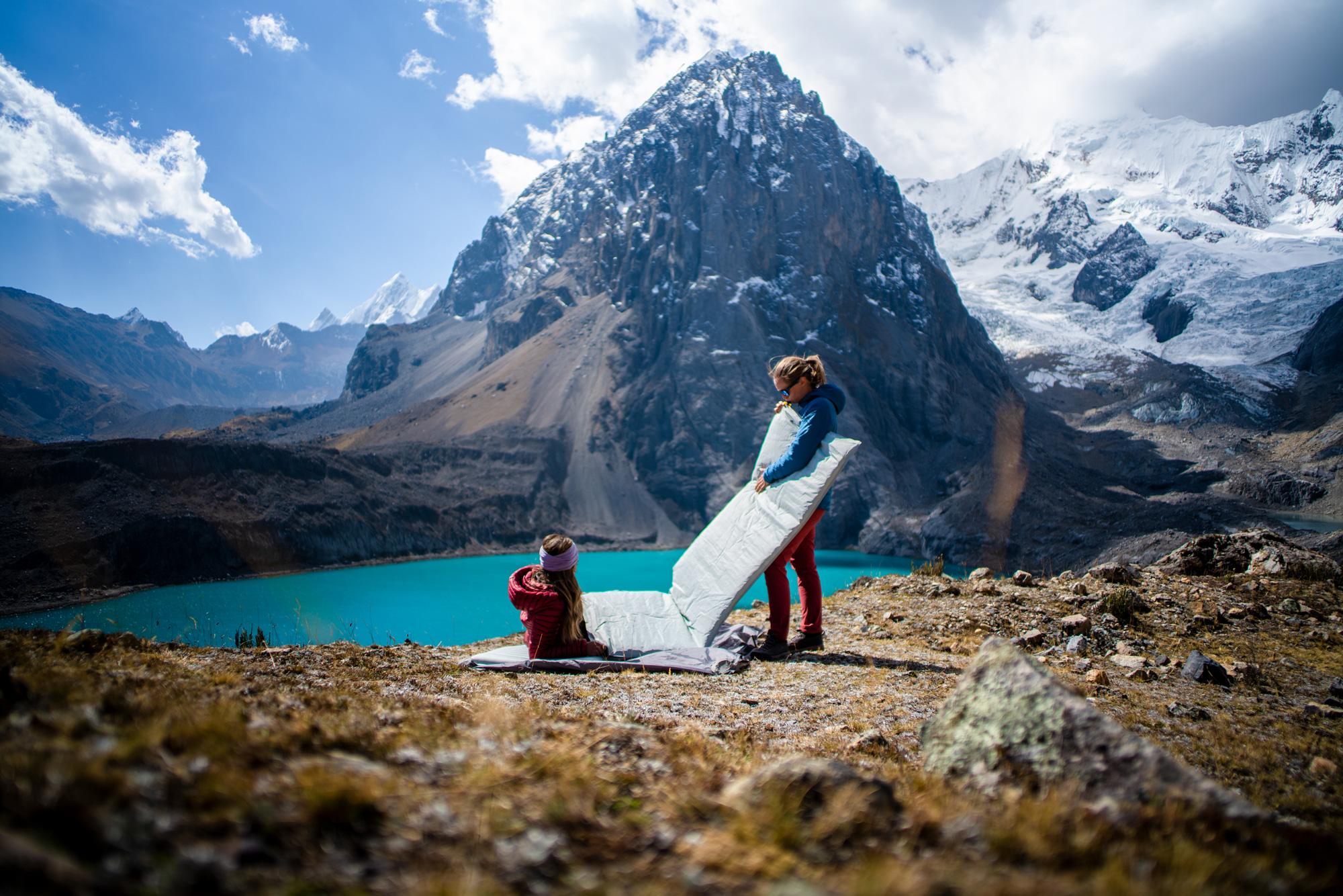 Inflating sleeping pad on backpacking trip