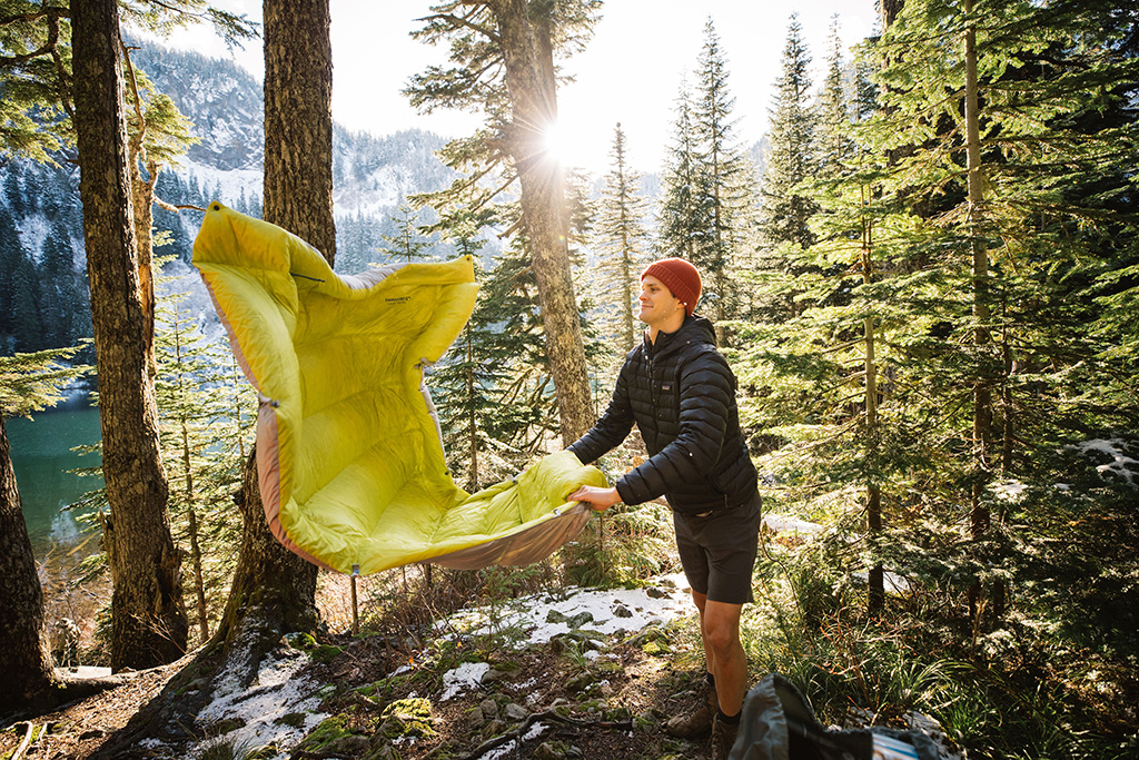 shaking out backpacking quilt