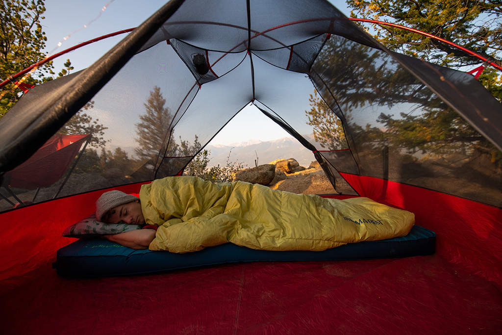 sleeping in tent with camping quilt