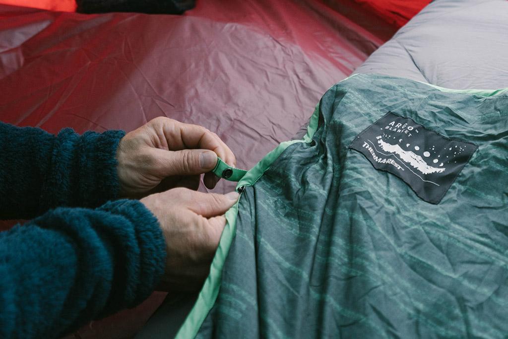 securing blanket to sleeping pad
