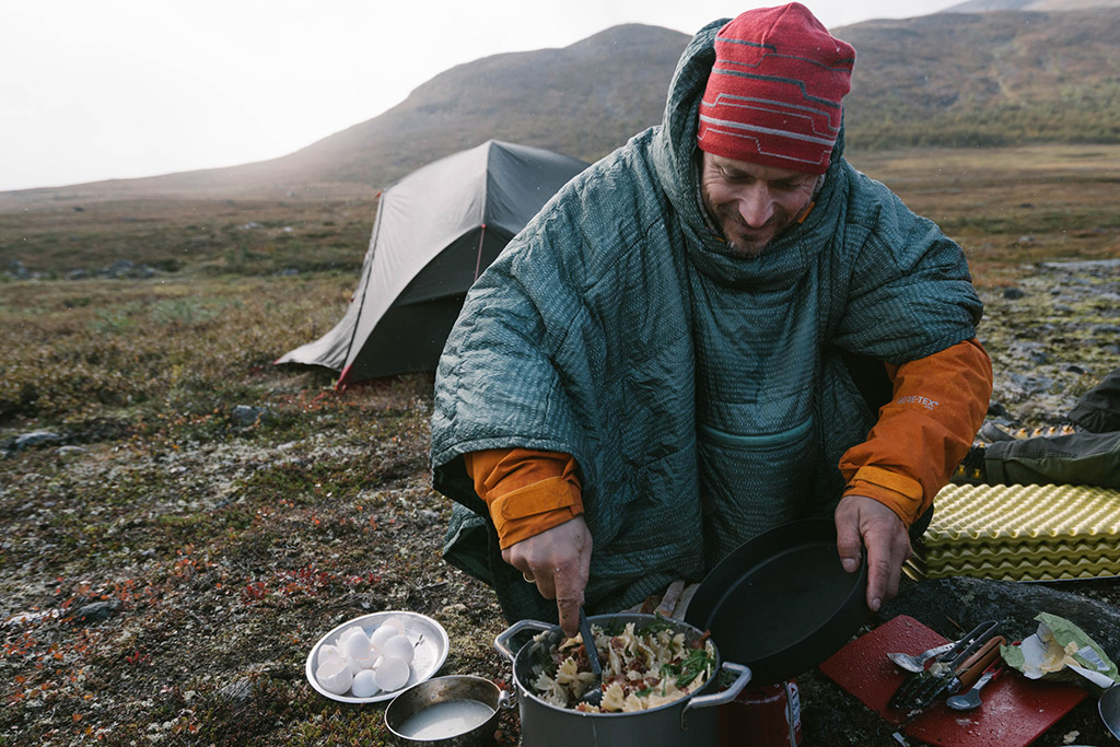 camping poncho in backcountry