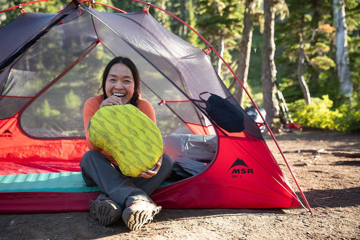 inflating pillow in tent