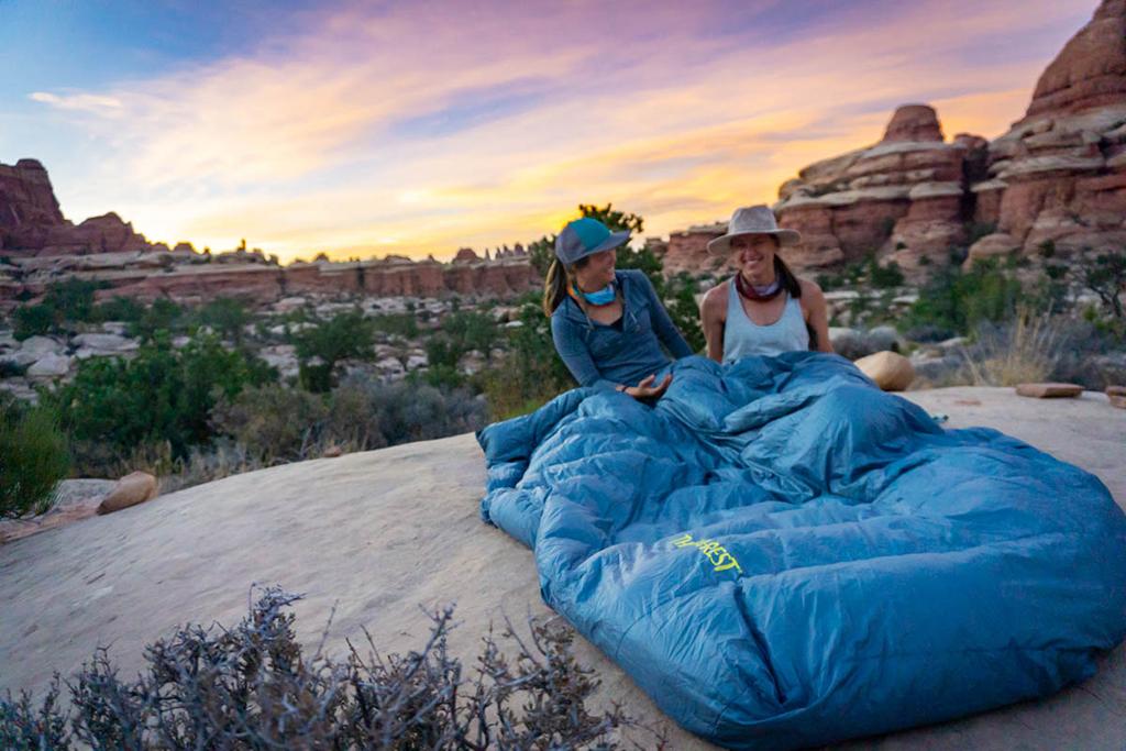 sitting in sleeping bag while camping in southern utah