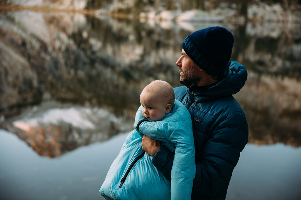 holding baby while backpacking