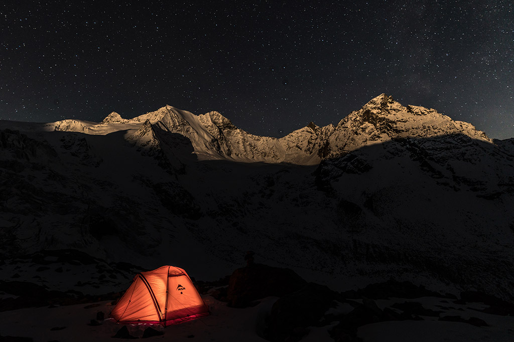 winter camping at night in MSR tent
