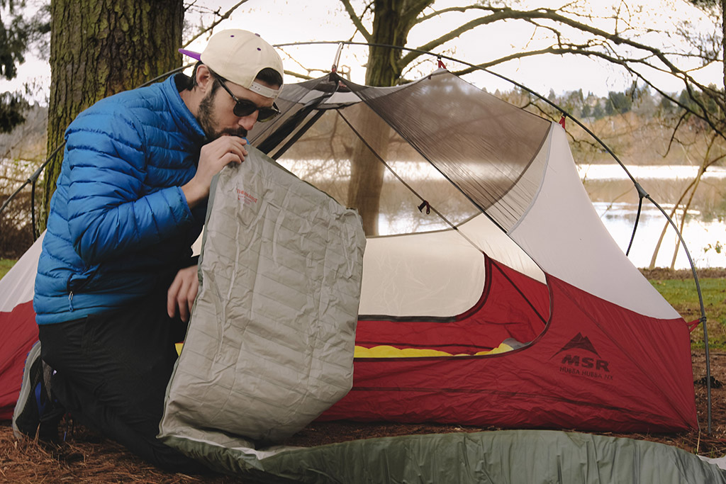 blowing up sleeping pad on backpacking trip