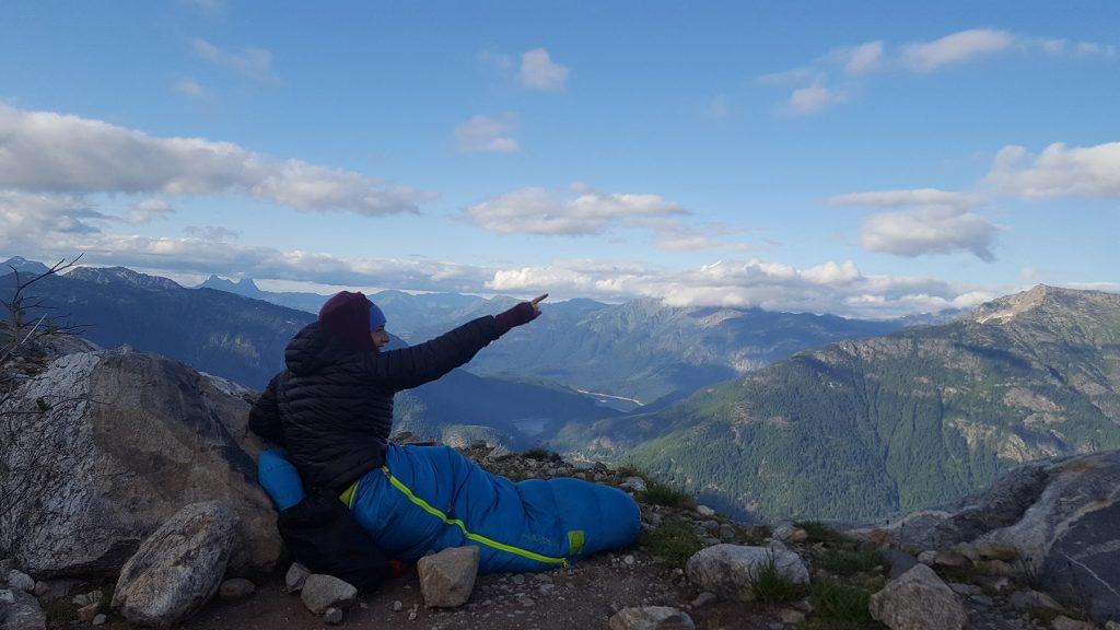 sitting in alpine climbing sleep system