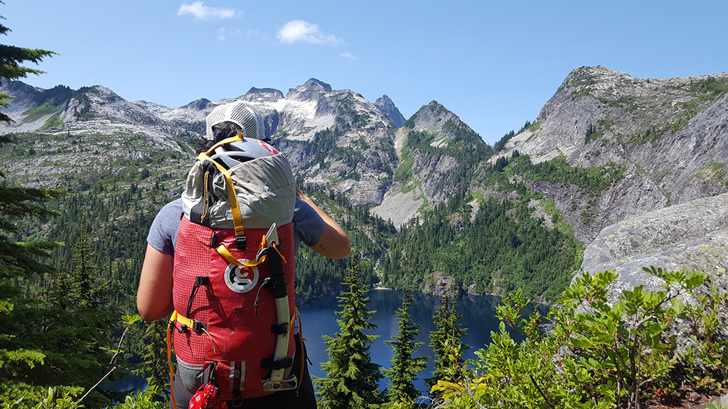 alpine climbing gear packed in backpack