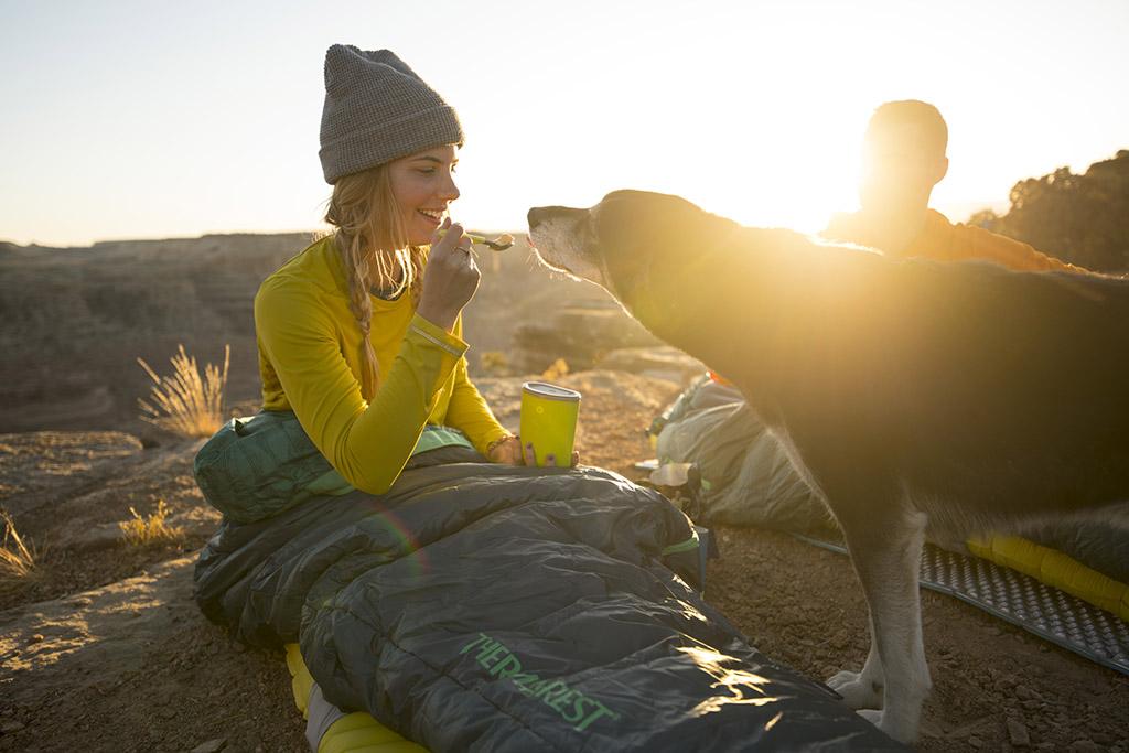 feeding dog on hiking trip