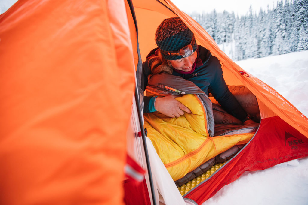 sitting in tent in winter sleeping bag