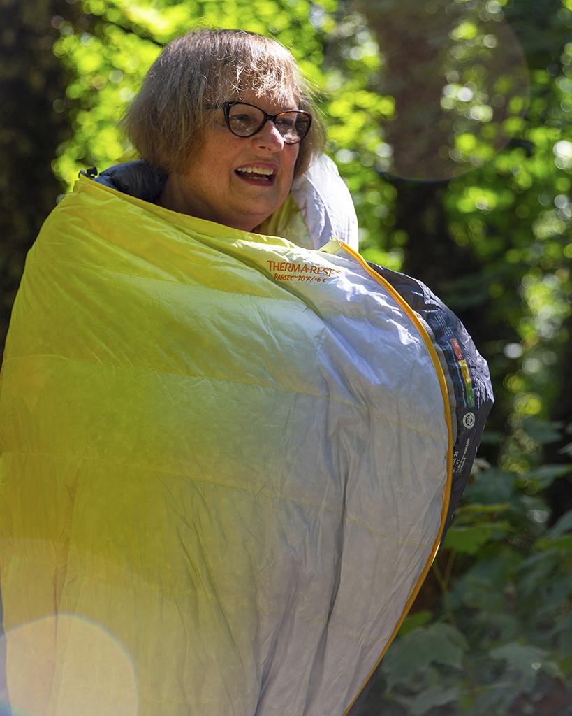standing in sleeping bag on mountaineering trip
