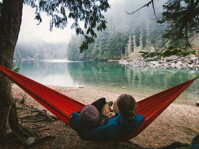 Two people in hammock at an alpine lake